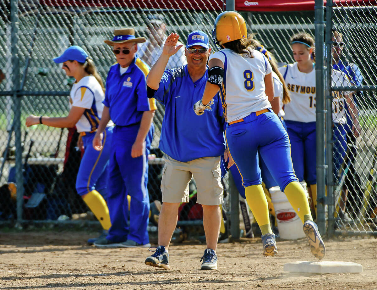 Seymour's Rebecca Findley is congratulated by Ken Pereiras after hitting a homerun during the Class M semi-final softball game against Stonington at the Dunn Sports Complex in Meriden, Conn. on Monday June 6, 2016. Seymour advanced to the Class M finals after beating Stonington 10-1.