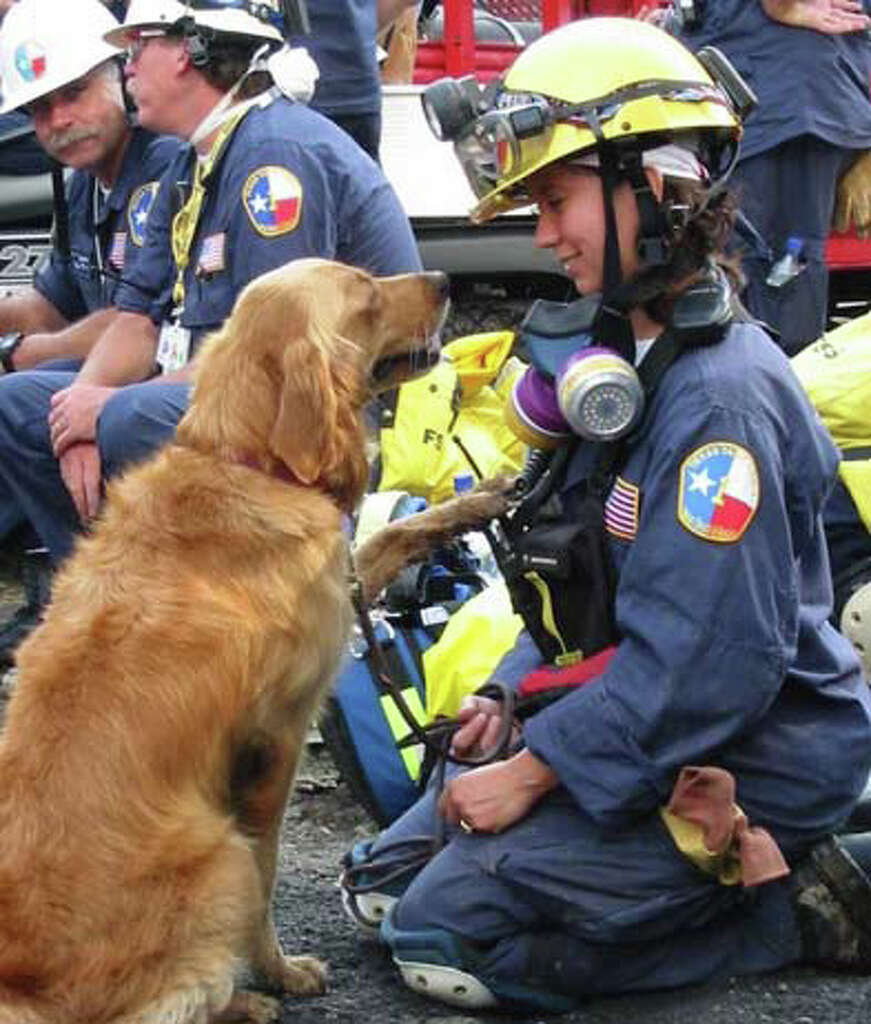 K9 Search Specialist Denise Corliss and her search dog Bretagne went to Ground Zero in New York City to work the site of the World Trade Center terrorist attack. Photo: Ravi Maini, Photo Courtesy Cy-Fair Volunteer Fire Department
