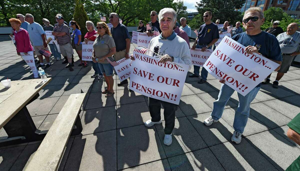 Demonstrators from the Teamsters union rally outside the Federal Building Monday June 6, 2016 in Albany, N.Y. They demonstrating the possible cuts in pension benefits. (Skip Dickstein/Times Union)