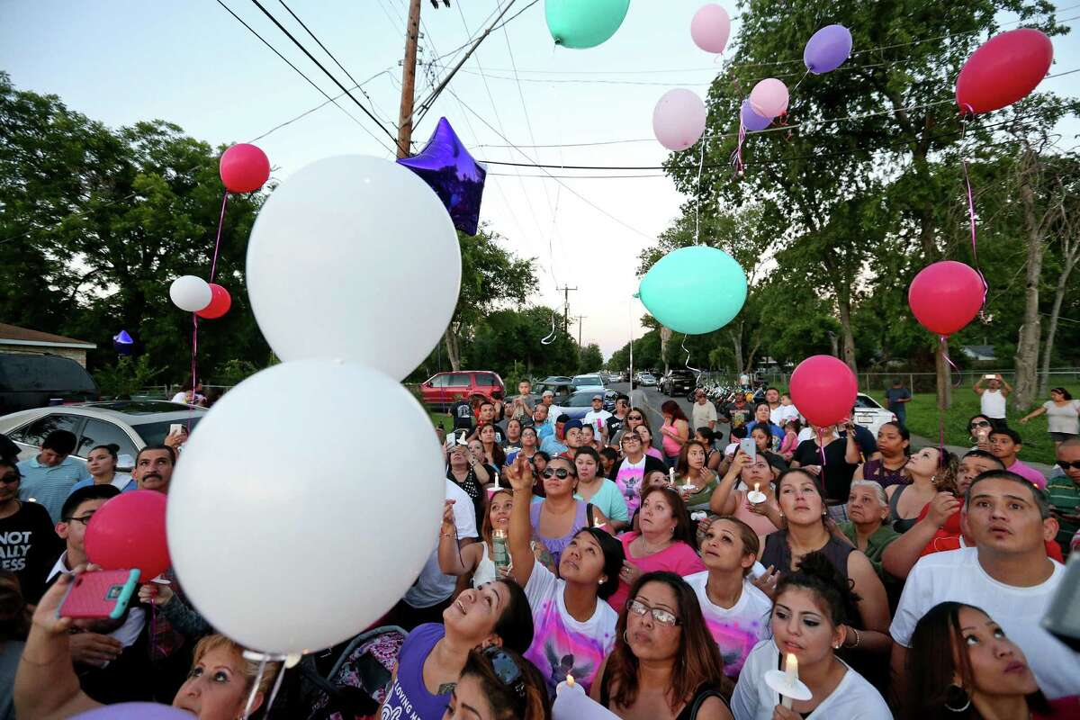 People release balloons during a candlelight vigil held Monday June 6, 2016 in remembrance of 7-year-old Iris Rodriguez who was fatally shot in the 5500 block of San Fernando Street Wednesday June 1, 2016 and died at University Hospital Thursday evening. About 200 people attended the vigil.