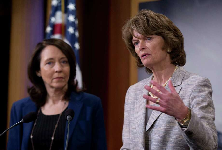 In this photo taken April 20, 2016, Senate Energy and Natural Resources Committee Chair Sen. Lisa Murkowski, R-Alaska, right, accompanied by the committee's ranking member, Sen. Maria Cantwell, D-Wash., speak about energy policy modernization during a news conference on Capitol Hill in Washington. Congressional efforts to approve the first major energy bill in nearly a decade are in jeopardy amid a partisan dispute over oil drilling, water for drought-stricken California and potential rollback of protections for the gray wolf and other wildlife.  (AP Photo/Manuel Balce Ceneta) Photo: Manuel Balce Ceneta, STF / Copyright 2016 The Associated Press. All rights reserved. This material may not be published, broadcast, rewritten or redistributed without permission.