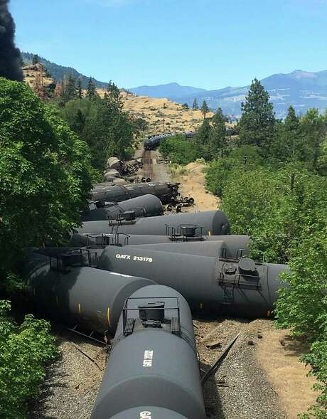 Oil tank cars were derailed Friday near Mosier, Ore. An estimated 42,000 gallons were released. About 10,000 gallons were recovered in wastewater systems. The rest was burned off, captured by booms or absorbed into soil, an official said.  Photo: Silas Bleakley, HONS / Silas Bleakley