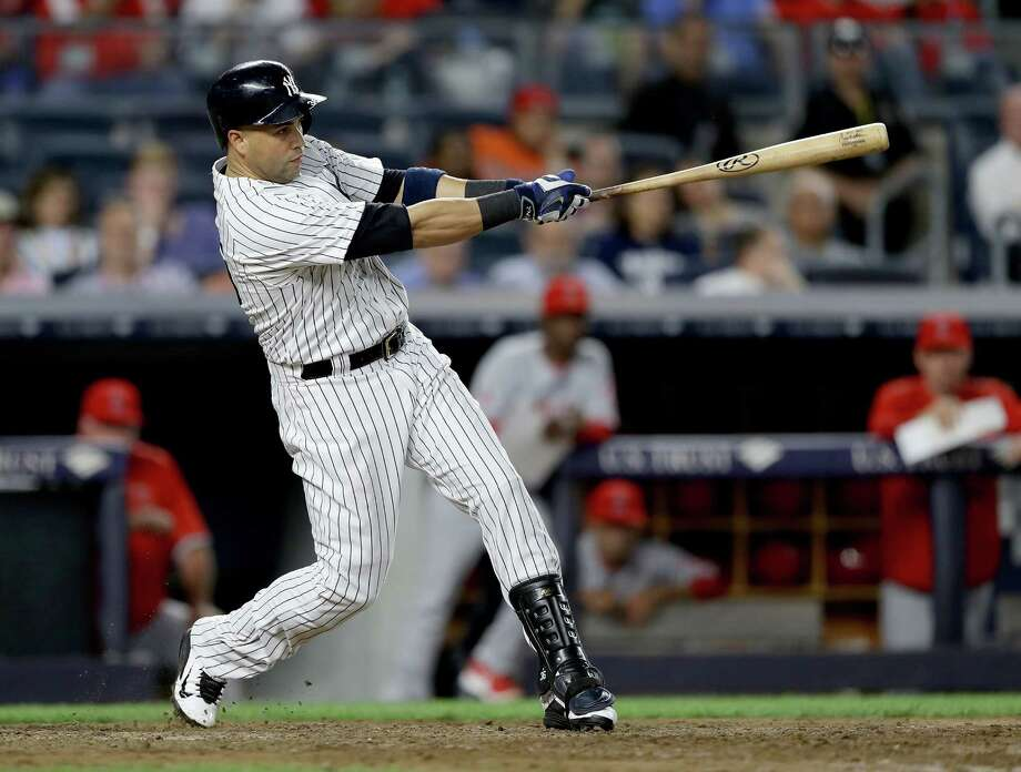 NEW YORK, NY - JUNE 06:  Carlos Beltran #36 of the New York Yankees hits a three run home run in the eighth inning against the Los Angeles Angels at Yankee Stadium on June 6, 2016 in the Bronx borough of New York City.The New York Yankees defeated the Los Angeles Angels 5-2.  (Photo by Elsa/Getty Images) ORG XMIT: 607679055 Photo: Elsa / 2016 Getty Images