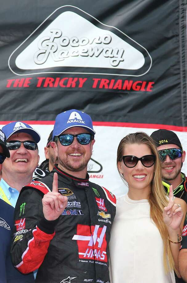 """LONG POND, PA - JUNE 06:  Kurt Busch, driver of the #41 Monster Energy/Haas Automation Chevrolet, and his girlfriend Ashley Van Metre pose in Victory Lane after winning the NASCAR Sprint Cup Series Axalta """"We Paint Winners"""" 400 at Pocono Raceway on June 6, 2016 in Long Pond, Pennsylvania.  (Photo by Sarah Crabill/Getty Images) Photo: Sarah Crabill, Stringer / 2016 Getty Images"""