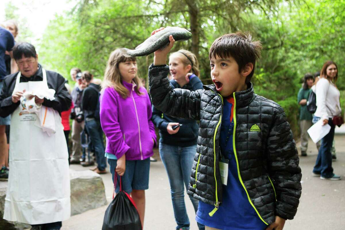 Diego Limon, age 8, holds a successfully caught fish. Limon was the the zoo for a field trip from his elementary school in Edmonds.