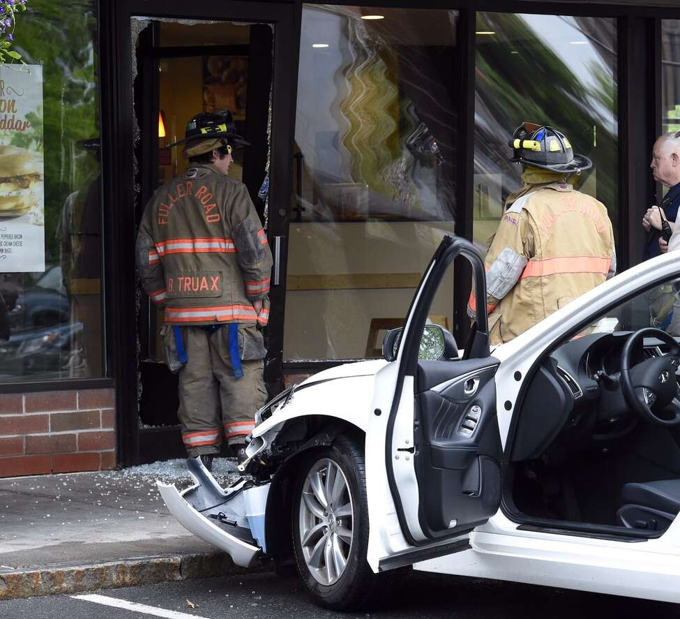 A car crashed into the Bruegger's Bagel Bakery on Wolf Road Tuesday morning, June 7, 2016. The car struck the front of the building but it was unclear if anyone was injured in the incident, which happened at about 7:30 a.m.(Skip Dickstein / Times Union)