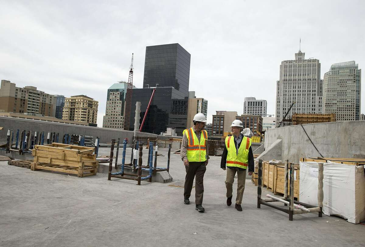 Ronald Alameida (left) and Fred Clarke walk on the roof of the Transbay Transit Center, which is currently under construction, during a tour in San Francisco, Calif., on Saturday, June 4, 2016. The roof will eventually become a park.