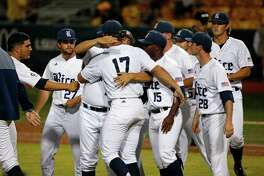 Rice pitcher Glenn Otto (17) is hugged by teammates after striking out the final at bat in the ninth inning against LSU in a college baseball regional tournament in Baton Rouge, La., Monday, June 6, 2016. Rice won 10-6. (AP Photo/Gerald Herbert)