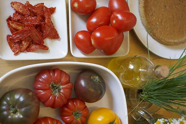Some of the ingredients seen in the kitchen to make heirloomed tomato tart with camomile and ricotta cheese on Thursday, June 2, 2016 in San Francisco, Calif.