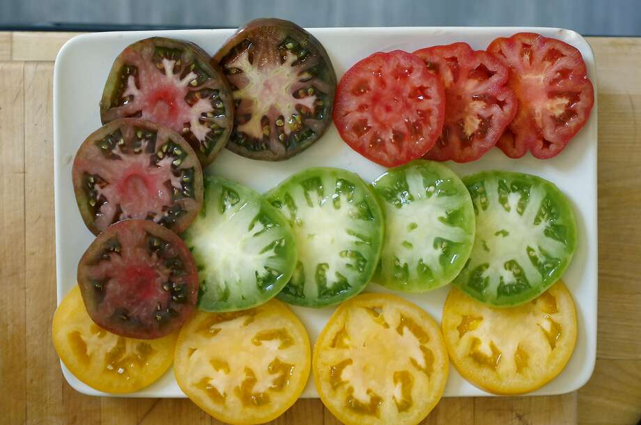 Sliced heirloom tomatoes for Craftsman and Wolves' chef William Werner's Tomato Tart. Photo: Liz Hafalia, The Chronicle