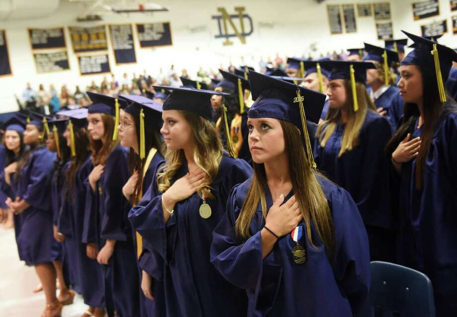 Rachael Watcke, of Shelton, puts her hand over her heart for the National Anthem before the Notre Dame High School commencement ceremony at Notre Dame High School in Fairfield, Conn. Friday, June 3, 2016. Photo: Tyler Sizemore / Hearst Connecticut Media / Greenwich Time