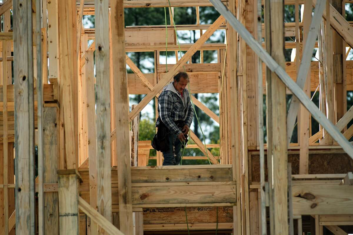 Work continues on a Taylor Morrison Home in the new Notchwood subdivision in Creekside Park in The Woodlands on Nov. 12, 2015. (Photo by Jerry Baker/Freelance)