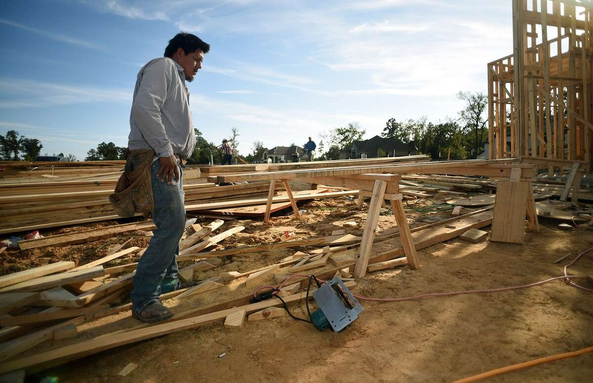 Work continues on a Taylor Morrison Home in the new Notchwood subdivision in The Woodlands on Nov. 12, 2015. (Photo by Jerry Baker/Freelance)