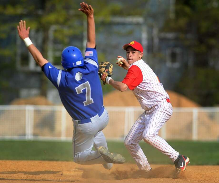 Stratford second baseman Mike Cody turns a double play as Bunnell's Tyler Wegrzyn looks to break up the play in the 6th inning of Wednesday's matchup at Penders Field in Stratford. Stratford won the game 5-0. Photo: Brian A. Pounds / Connecticut Post