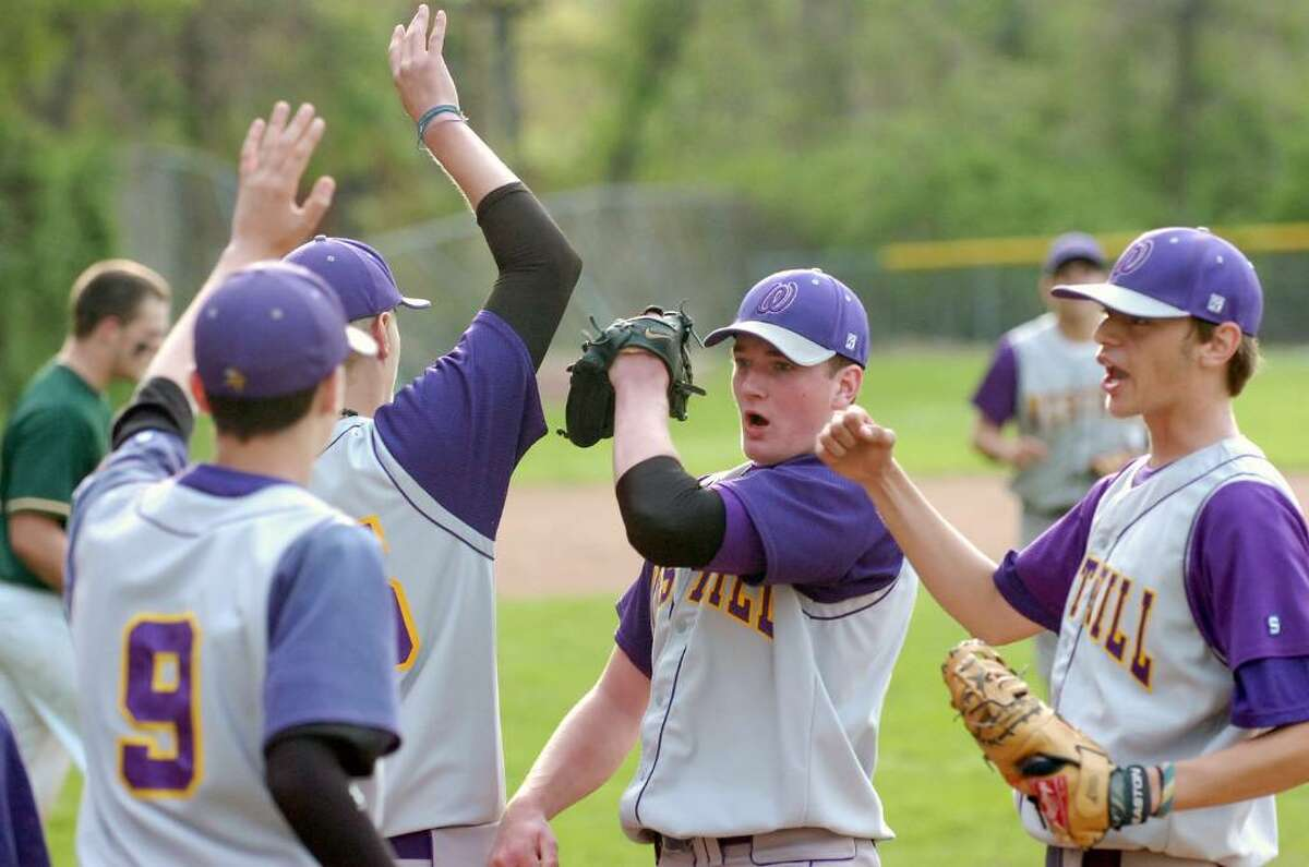 Westhill pitcher John Porter, center, and teammates celebrate their win over Trinity Catholic after a baseball game at Trinity Wednesday, April 21, 2010. Westhill won 5-1.