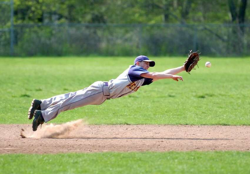 Westhill's Scott Valenzano dives for a ball as Trinity Catholic hosts Westhill High School in a boys baseball game Wednesday, April 21, 2010. Westhill won 5-1.