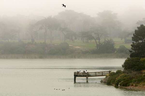 A blanket of fog moves across Lake Merced in San Francisco, Calif., on July 10, 2008, obscuring Harding Park Golf Course, dropping the temperature to  60 degrees in the early afternnon. Cooler temperatures along the San Francisco coastline are expected to slowly move across the entire Bay Area over the next few days. Photo By Michael Macor/ The Chronicle