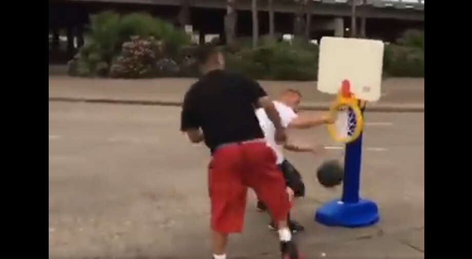 A video posted to Facebook shows two men holding up traffic to play basketball in the street. A Redditor said the video was shot in Houston. Photo: Facebook Video Posted By Monsee Cortes