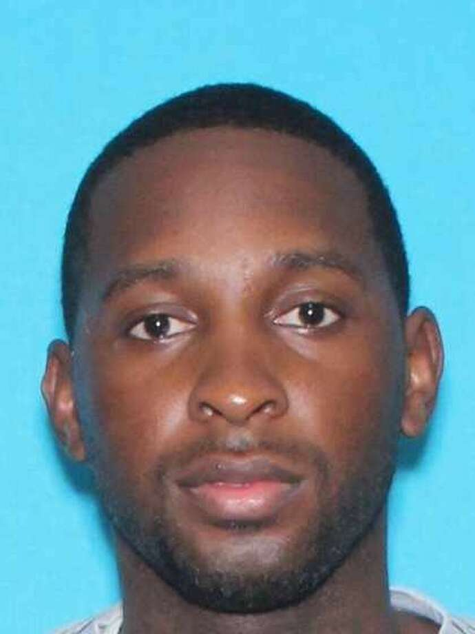 Police were searching for Darrell Mitchell, 28, after a shooting left a woman dead and a man critically wounded early Tuesday.