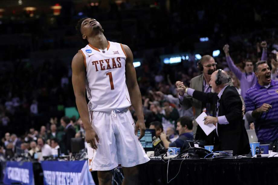 OKLAHOMA CITY, OK - MARCH 18:  Isaiah Taylor #1 of the Texas Longhorns reacts after Paul Jesperson #4 of the Northern Iowa Panthers hit a half court three pointer at the buzzer to win the game with a score of 75 to 72 during the first round of the 2016 NCAA Men's Basketball Tournament at Chesapeake Energy Arena on March 18, 2016 in Oklahoma City, Oklahoma.  (Photo by Ronald Martinez/Getty Images) Photo: Ronald Martinez, Staff / Getty Images / 2016 Getty Images