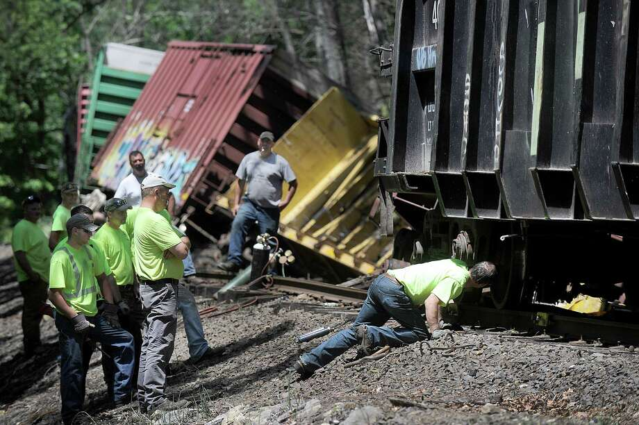 Crews from the Housatonic Railroad Co. work on a cargo train that derailed in the Gaylordsville sectuib if New Milford over the weekend. Photo: Carol Kaliff / Hearst Connecticut Media / The News-Times