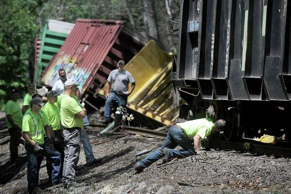 Crews from the Housatonic Railroad Co. work on a cargo train that derailed in the Gaylordsville sectuib if New Milford over the weekend.