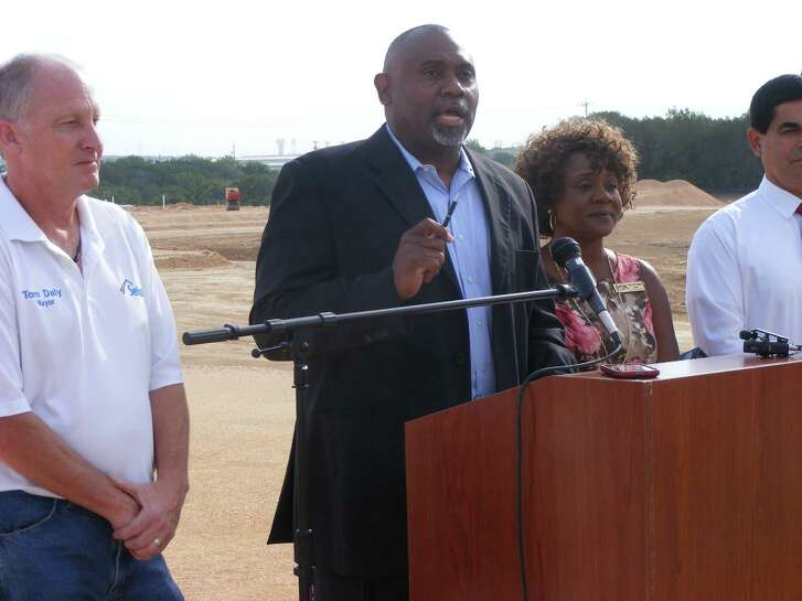 Judson Superintendent Willis Mackey, center, is flanked by mayors Tom Daly of Selma, left, and Mary Dennis of Live Oak, right, at a school event in July 2014. The Judson ISD board of trustees on Tuesday voted to rescind naming the district's newest high school after Mackey, who has retired, and instead naming it Veterans Memorial High School.