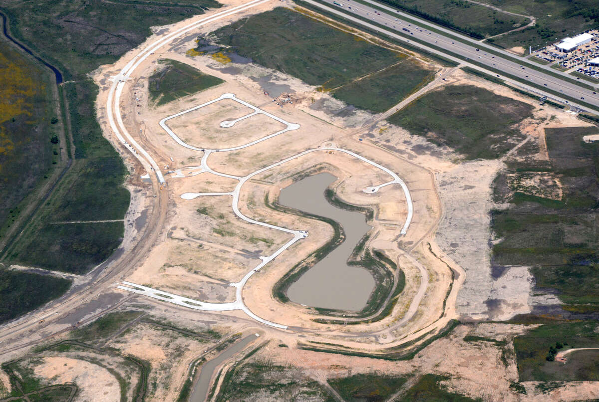 Home sites and roads are being constructed for the planned Lago Mar community in Texas City.