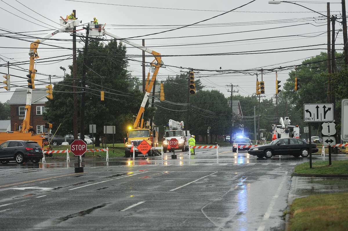 A United Illuminating crew works to repair a power outage that closed Main Street to traffic north of the intersection with Barnum Avenue in Stratford, Conn. on Tuesday, August 11, 2015.