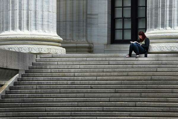 A person enjoys the beautiful weather on the steps of the New York State Education Department building Tuesday morning June 7, 2016 in Albany, N.Y. (Skip Dickstein/Times Union)