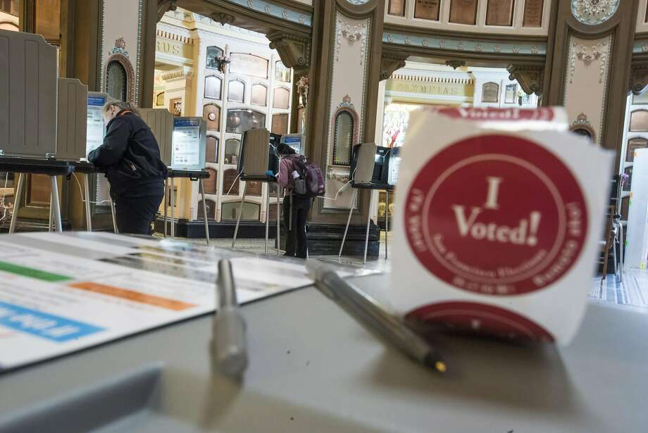"An ""I Voted"" sticker sits on a table as residents make selections on their ballots while voting in the San Francisco Columbarium polling location during the presidential primary election in San Francisco, California, U.S., on Tuesday, June 7, 2016. Hillary Clinton secured the delegates required to claim the Democratic presidential nomination Monday, putting further pressure on Bernie Sanders to exit the race. Photographer: David Paul Morris/Bloomberg Photo: David Paul Morris, Bloomberg"