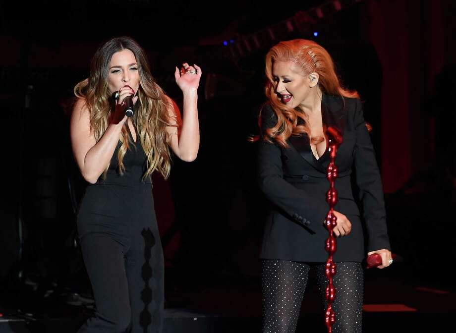 "I hang on every endorsement: Singers Alisan Porter, left, and Christina Aguilera perform onstage during the ""Hillary Clinton: She's With Us"" concert at The Greek Theatre in Los Angeles, Monday, June 6. Photo: Kevin Winter / Getty Images / 2016 Getty Images"
