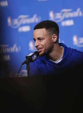 Warriors' Stephen Curry answers question during a media availability at Quicken Loans Arena in Cleveland, Ohio on Tues. June 7, 2016, as the teams prepare for game 3 of the NBA Championship.
