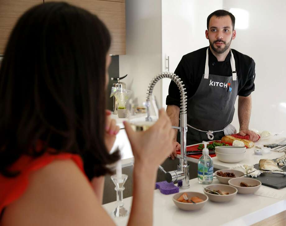 Andrew Menard discusses the food he prepared for a Kitchit Tonight dinner last year in San Francisco. Kitchit officially shut down in April. Photo: Connor Radnovich, The Chronicle