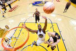 OAKLAND, CA - JUNE 05:  Harrison Barnes #40 of the Golden State Warriors goes up for the ball alongside Kevin Love #0 of the Cleveland Cavaliers in the first half in Game 2 of the 2016 NBA Finals at ORACLE Arena on June 5, 2016 in Oakland, California. NOTE TO USER: User expressly acknowledges and agrees that, by downloading and or using this photograph, User is consenting to the terms and conditions of the Getty Images License Agreement.  (Photo by Bob Donnan/Pool/Getty Images)