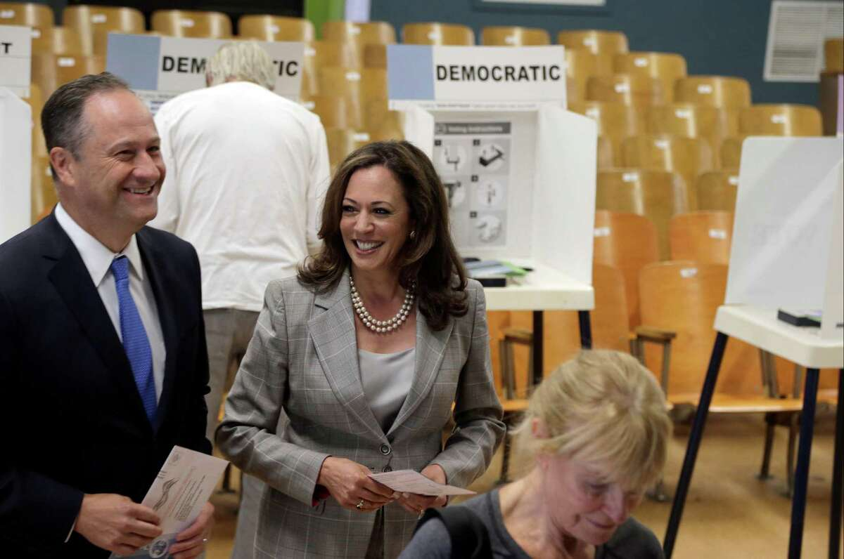 California Attorney General Kamala Harris, center, with her husband, Douglas Emhoff cast their ballots in Tuesday's presidential contest, at the Kenter Canyon Elementary School in Los Angeles, on Tuesday, June 7, 2016. Democratic presidential rivals Hillary Clinton and Bernie Sanders prepared for a final contest in California with a blitz of TV ads and hand-shaking in a state where voters have enjoyed a rare turn in the spotlight this year.