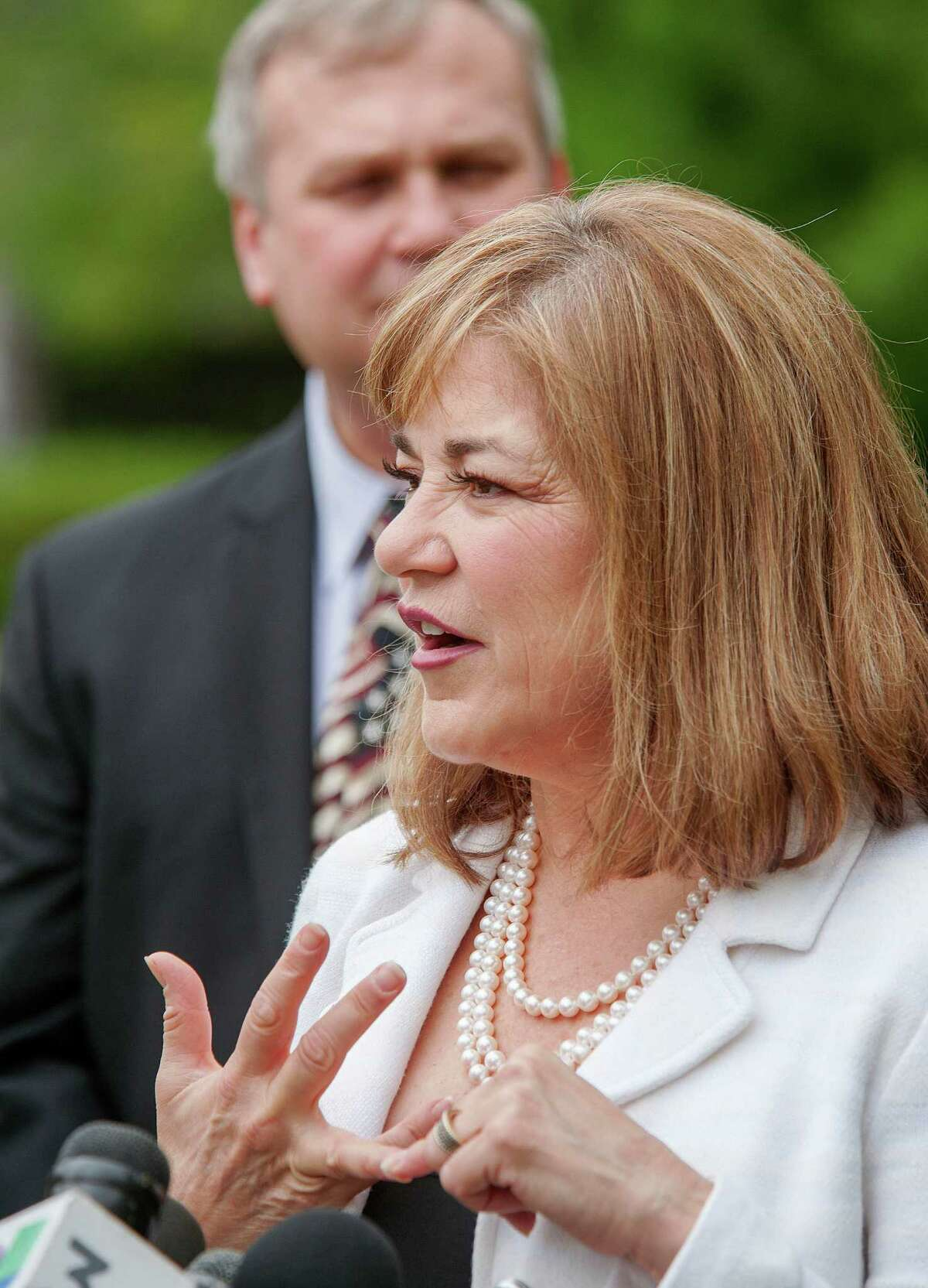 U.S. Rep. Loretta Sanchez answers questions after casting her ballot during a short press conference as her husband Jack Einwechter of Orange listens, Tuesday, June 7, 2016, at Orange High School, in Orange, Calif. Sanchez is running against California Attorney General Kamala Harris for the United States Senate seat replacing retiring Sen. Barbara Boxer.