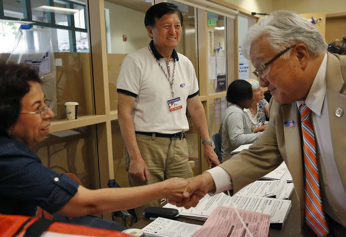 U.S. Representative Mike Honda, right, greets Election Officials, from left, Martha Neal and Bo Sher at a polling place in the City of Santa Clara Senior Center June 7, 2016 in San Jose, Calif.
