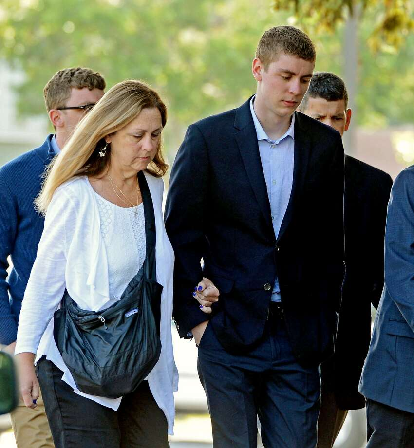 FILE - In this June 2, 2016 file photo, Brock Turner, right, makes his way into the Santa Clara Superior Courthouse in Palo Alto, Calif. A letter written by Turner's father was made public over the weekend by a Stanford law professor who wants the judge in the case removed from office because Brock Turner's sentencing. (Dan Honda/Bay Area News Group via AP, File) MAGS OUT NO SALES Photo: Dan Honda, Associated Press