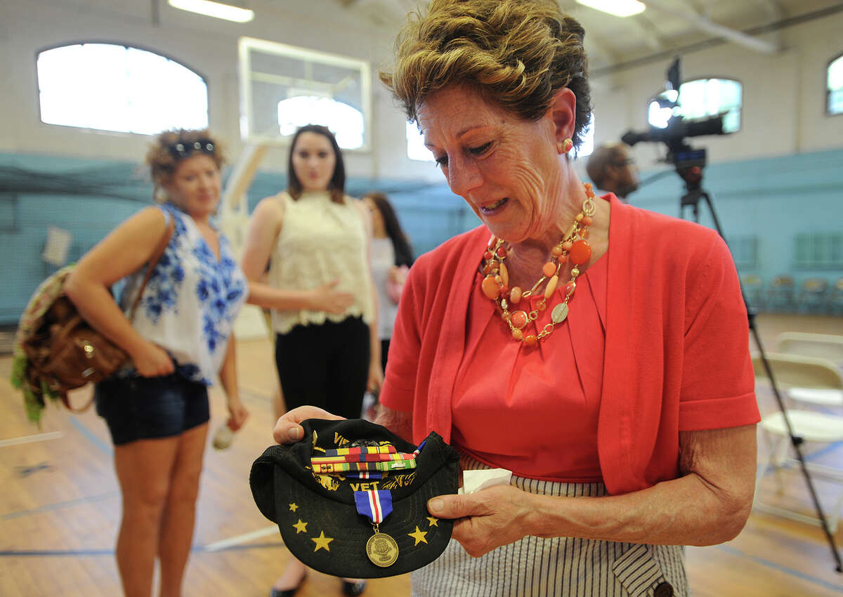 Jeanne DelVecchio, of Bethany, looks at the medal she received for her husband, Vietnam War Marine veteran Salvatore DelVecchio, at the Connecticut Veterans Wartime Service Medal ceremony at the Ansonia Armory in Ansonia, Conn. on Tuesday, June 7, 2016.