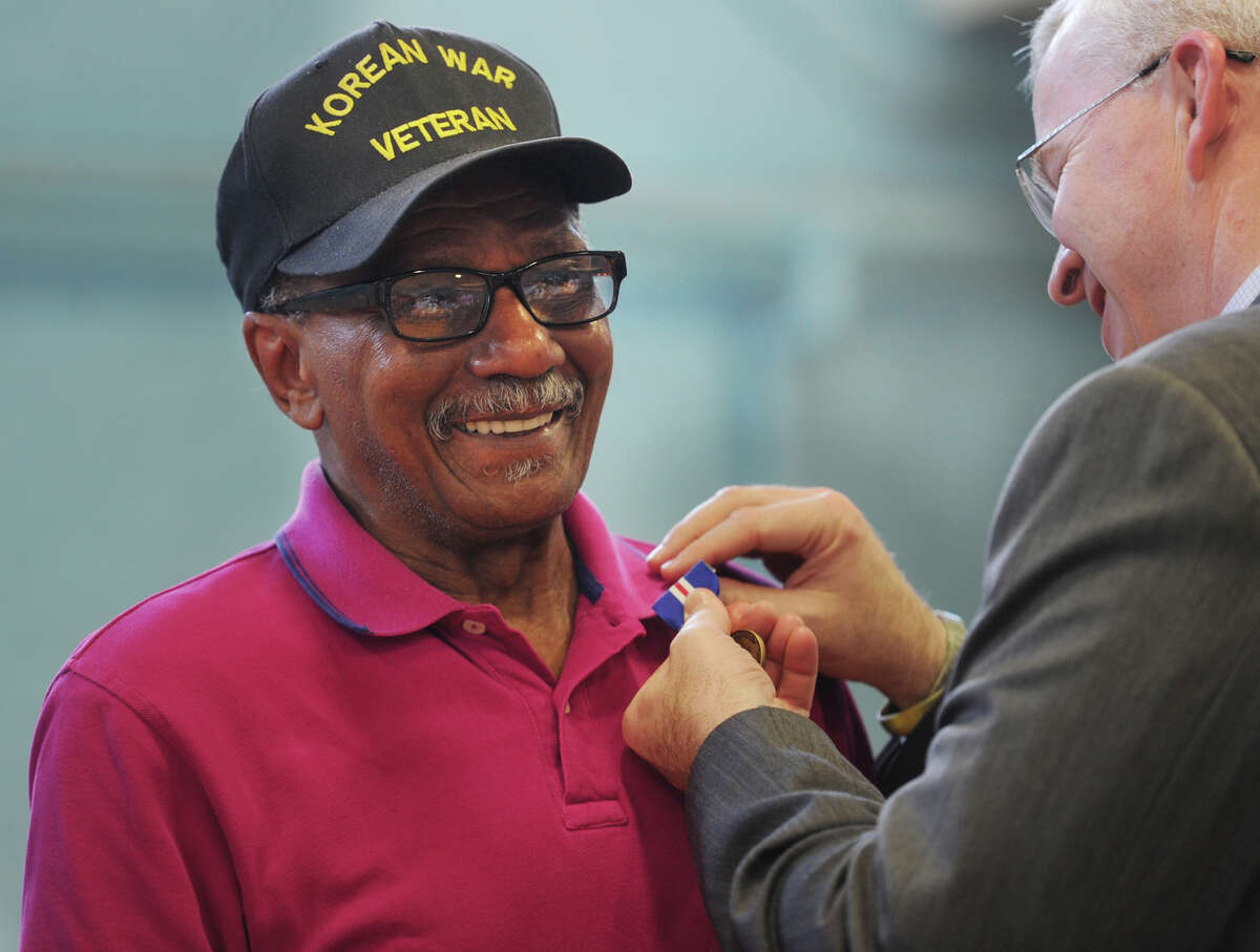 Air Force veteran John Antrum, of Ansonia, is pinned with the Connecticut Veterans Wartime Service Medal by Veterans' Affairs Commissioner Sean Connolly during a ceremony at the Ansonia Armory in Ansonia, Conn. on Tuesday, June 7, 2016. Thirty-two awards were presented during the event.