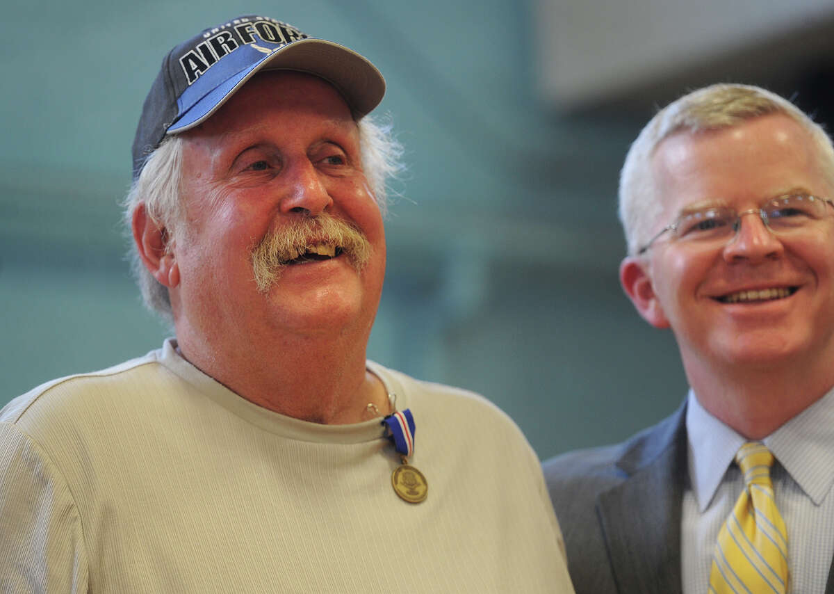 Air Force veteran Jerome Fainer, of Ansonia, smiles as he poses for a photo with Veterans' Affairs Commissioner Sean Connolly at the Connecticut Veterans Wartime Service Medal ceremony at the Ansonia Armory in Ansonia, Conn. on Tuesday, June 7, 2016. Thirty-two awards were presented during the event.