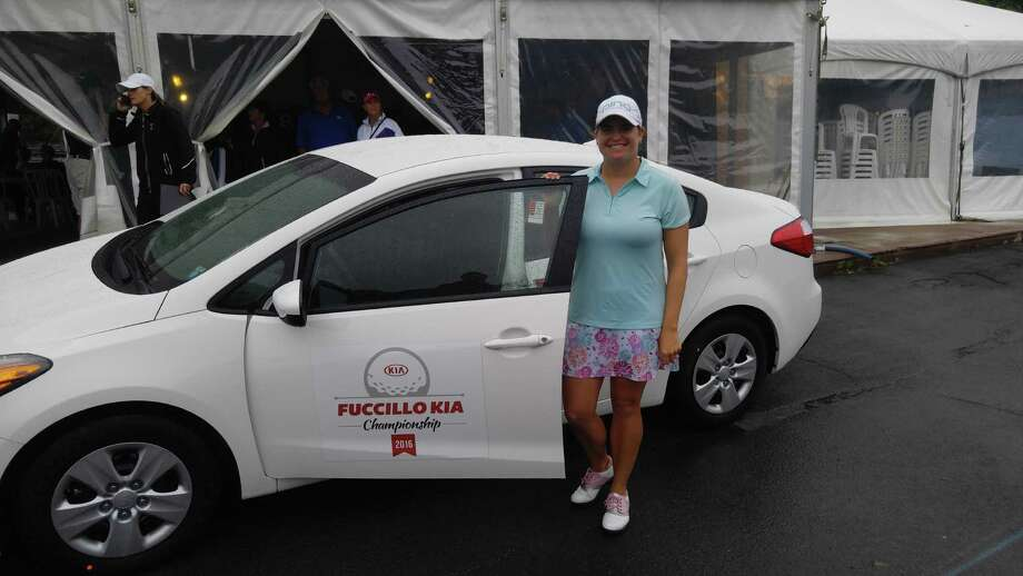 Jackie Stoelting of Vero Beach, Fla., stands alongside the 2016 Kia Forte LX, which she won for capturing the Symetra Tour's Fuccillo Kia Championship on Sunday, June 5, 2016, at Capital Hills. (Pete Dougherty/Times Union)