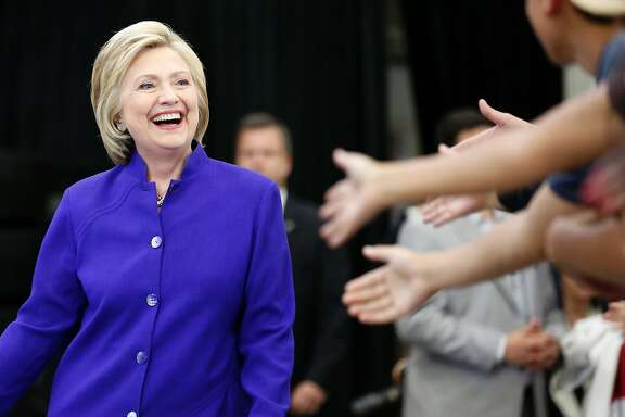 TOPSHOT - Hillary Clinton greets supporters during a rally at Long Beach City College on the final day of California campaigning, June 6, 2016 in Long Beach, California.  Hillary Clinton has received commitments from enough delegates to clinch the Democratic presidential nomination, according to the Associated Press and US networks, ensuring she will be the first woman to lead a major US party in the race for the White House. / AFP PHOTO / JONATHAN ALCORNJONATHAN ALCORN/AFP/Getty Images