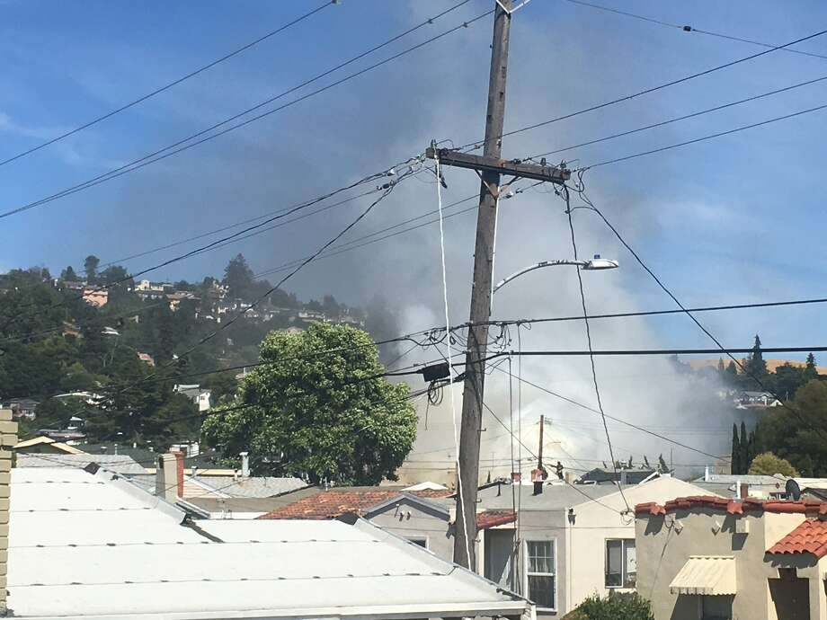 Smoke could be seen billowing from the building on fire in East Oakland on Tuesday afternoon. Photo: Oakland Fire Department