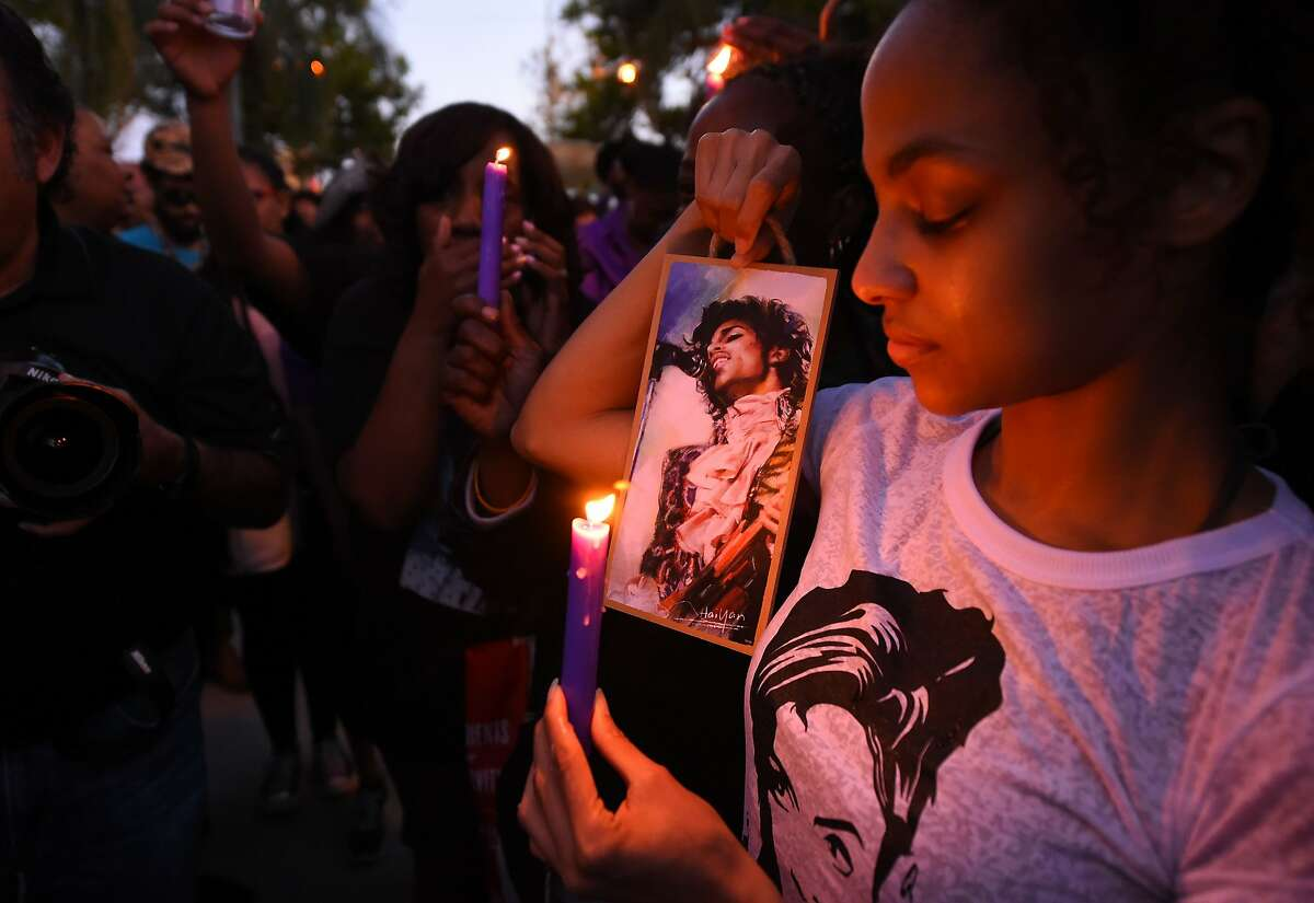 (FILES) This file photo taken on April 21, 2016 shows People attending a candlelight vigil for pop music icon Prince, April 21, 2016 at Leimert Park in Los Angeles, California. Prince died from an overdose of painkillers, a report said on June 2, 2016, quoting the ongoing investigation. The Star Tribune newspaper in Prince's hometown Minneapolis quoted an anonymous source as saying that the singer had overdosed on opioid pain medication. Officials declined comment. / AFP PHOTO / ROBYN BECKROBYN BECK/AFP/Getty Images