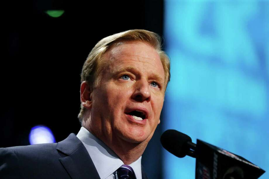 """FILE - In this Thursday, April 28, 2016 file photo, NFL commissioner Roger Goodell announces a selection during the first round of the 2016 NFL football draft in Chicago. The NFL has """"engaged law enforcement"""" to see how its Twitter account was hacked with a post purporting that Commissioner Roger Goodell had died, Tuesday, June 7, 2016.(AP Photo/Charles Rex Arbogast, File) ORG XMIT: NY168 Photo: Charles Rex Arbogast / AP"""
