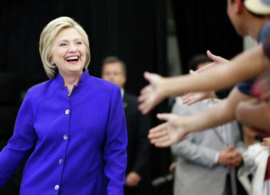 Hillary Clinton greets supporters during a rally at Long Beach City College on the final day of California campaigning, June 6, 2016, in Long Beach, Calif.  Clinton has received commitments from enough delegates to clinch the Democratic presidential nomination, according to the Associated Press and U.S. networks, ensuring she will be the first woman to lead a major U.S. party in the race for the White House. (Jonathan Alcorn / AFP/ Getty Images) Photo: JONATHAN ALCORN, Stringer / AFP or licensors