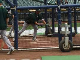 Sean Manaea of the Oakland A's takes batting practice at Miller Park before an interleague game with the Milwaukee Brewers.