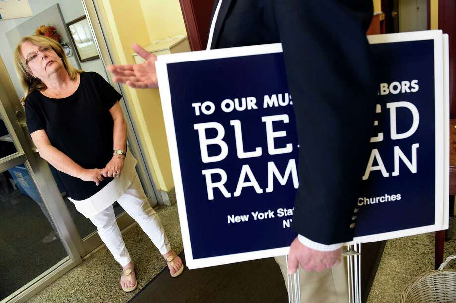 Deb Riitano, executive director of Capital Area Council of Churches, left, talks with Deacon Walter Ayres of Catholic Charities, who purchased Ramadan signs, on Tuesday, June 7, 2016, at First Lutheran Church in Albany, N.Y. (Cindy Schultz / Times Union) Photo: Cindy Schultz / Albany Times Union
